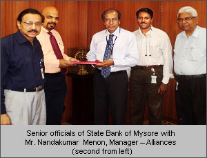 Senior Officials of State Bank of Mysore with Mr. Nandakumar Menon, Manager -  Alliances (second from left)