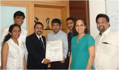 Mr. Neil Fernandez Country Risk Head India and South Asia- VISA presenting the Avenues Management Team the PCI-DSS version 2.0 Certificate
